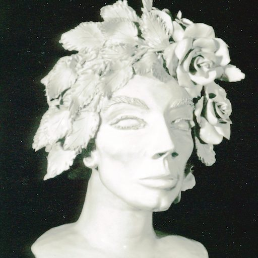 Head of woman crowned with flowers